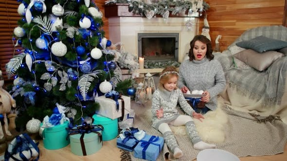Thumbnail for Happy Family Playing Near the Christmas Tree, Mother and Daughter in a Cozy Atmosphere in the House