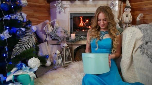 Thumbnail for Girl with a Gift, Christmas Gift Surprise, Beauty Girl Opens Christmas Gift Box with Miracle