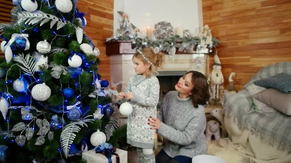Thumbnail for Family Decorating a Christmas Tree, Mother and Daughter Are Preparing for the New Year Holiday