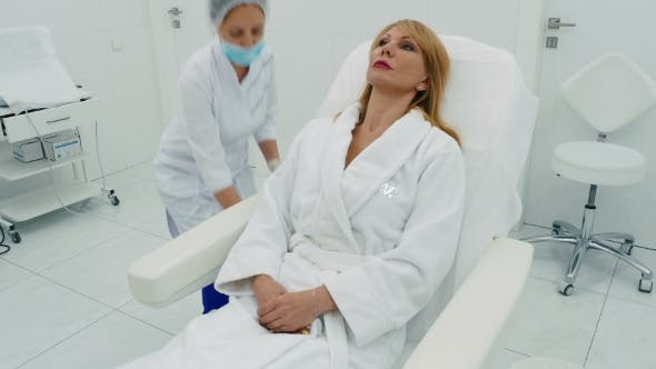 Thumbnail for Woman Sits in a Cosmetology Chair