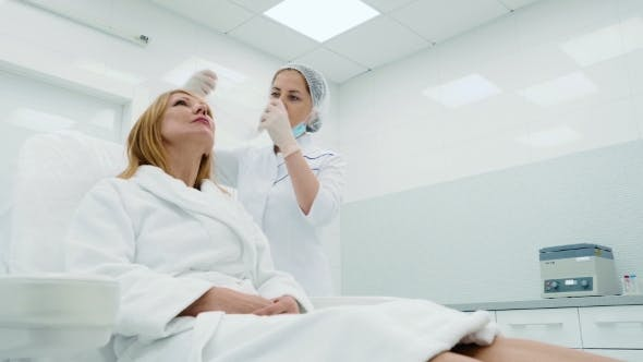 Thumbnail for Beautician Prepares a Woman To Procedures in a Cosmetology Clinic