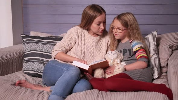 Thumbnail for Mother and Daughter Reading Story at Home Together