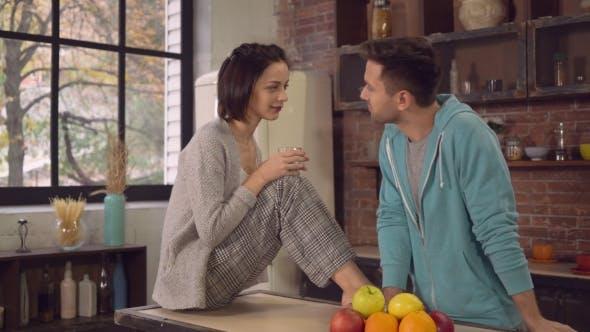 Friends in Apartment Talks in Kitchen.