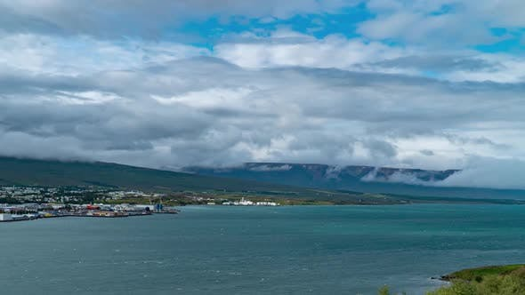 Thumbnail for Clouds Move Over Icelandic Town Akureyri and Fjord