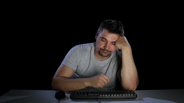 Thumbnail for Man Was Tired and Fell Asleep in Front of a Computer Monitor
