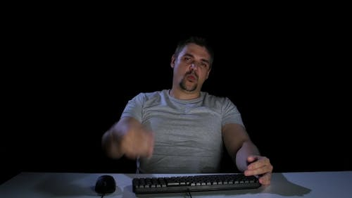 Man with Haughty Respond To an E-mail