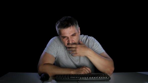 Thumbnail for Man Tired Effort on Keyboard Keys. Yawns. Emotions. Studio