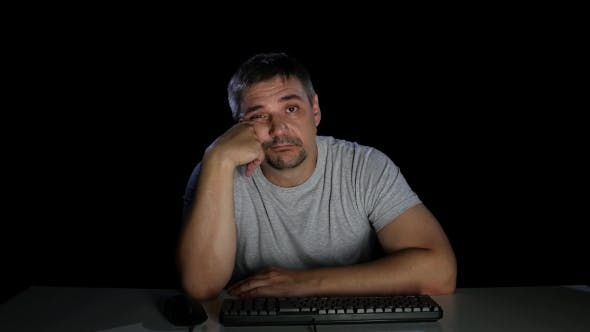Thumbnail for Man with Indifference Looking at a Computer Screen