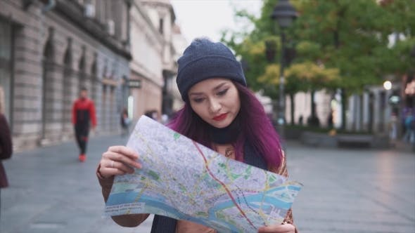 Thumbnail for Girl Tourist Walking with a Map on the Street