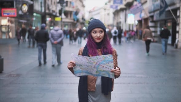 Thumbnail for Pretty Girl Walking with a Map on the Street