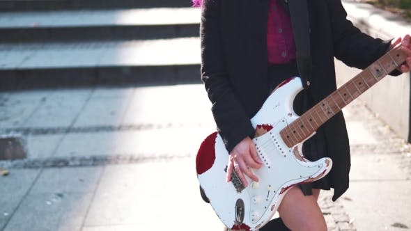 Cover Image for Young Rock Girl with Electric Guitar