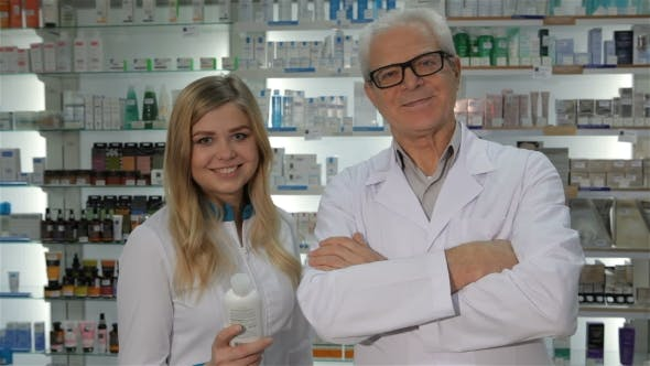 Thumbnail for Two Pharmacists Pose at the Drugstore