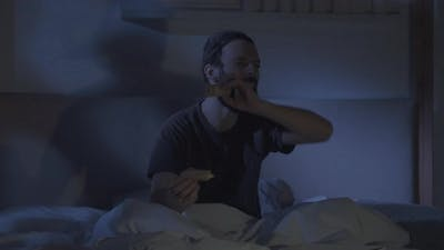 Night Movie Man Watching Comedy Tv Show in Bed