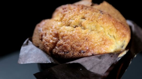 Thumbnail for Freshly Baked Muffin on a Black Background