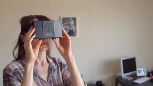 Thumbnail for Pretty Brunette Woman Using Her Mobile Phone VR Headset