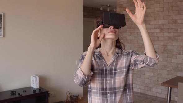 Thumbnail for Young Brunette Woman Using Her Phone VR Headset at Home