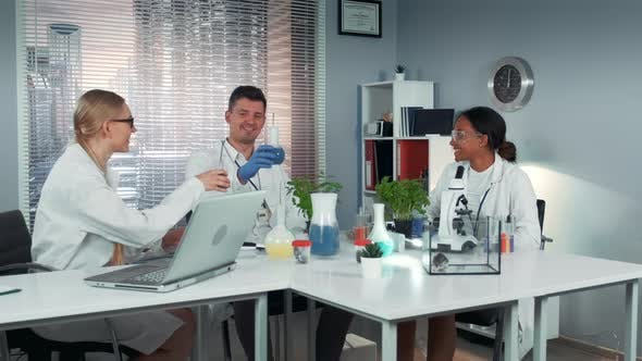 Thumbnail for Happy Multiracial Team of Scientists Making Toasts with Dry-ice Cocktails in Flasks