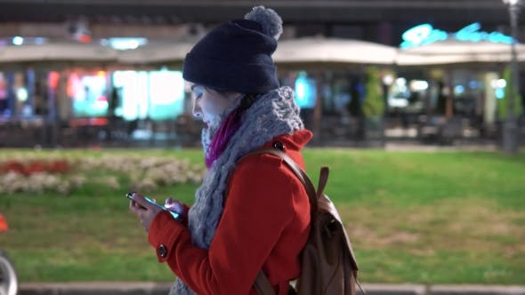 Thumbnail for Girl Holding Phone and Walking in the Street