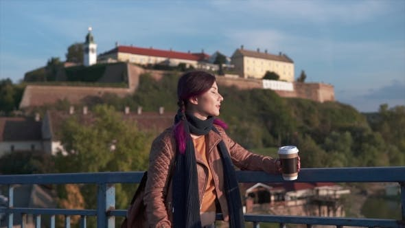 Thumbnail for Happy Tourist Girl Holding Coffee on the Bridge