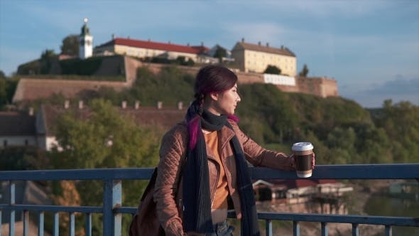 Thumbnail for Young Tourist Girl Holding Coffee on the Bridge