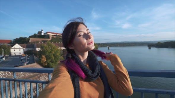 Thumbnail for Girl Tourist Taking Selfie on Phone on the Bridge