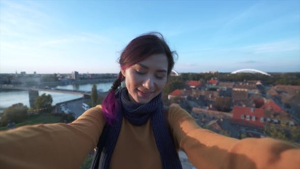 Thumbnail for Woman Tourist Taking Selfie on Phone in Fron of a City