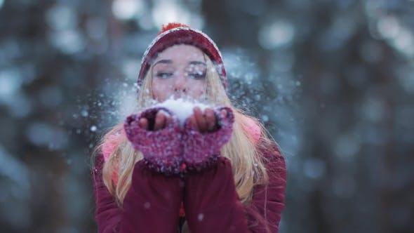 Thumbnail for Girl Blowing Snow in the Air in Winter Holidays