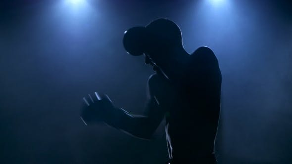 Thumbnail for Young Male Athlete Boxing in the Studio Visible in Silhouette