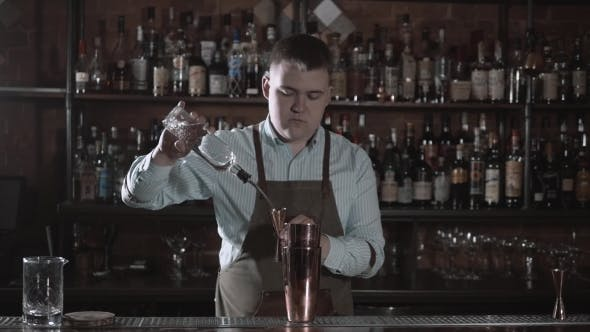 Thumbnail for American Bartending Calling Order. Bartender Pouring Vodka in One Tin and Shaker