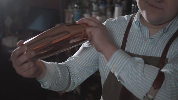 Thumbnail for Handsome Barman Smiling at Camera Making a Cocktail at the Bar and Shake