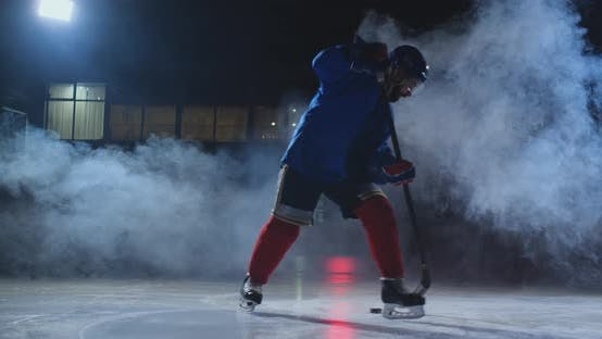 Thumbnail for Professional Hockey Player with a Stick Accelerates on the Ice and Stops Abruptly in Front of the