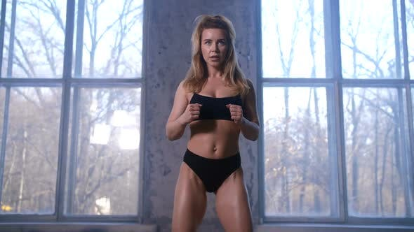 Thumbnail for Fitness Female Exercising with Resistance Band
