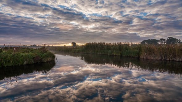 Thumbnail for Movement of Clouds Over a Lake at Dawn
