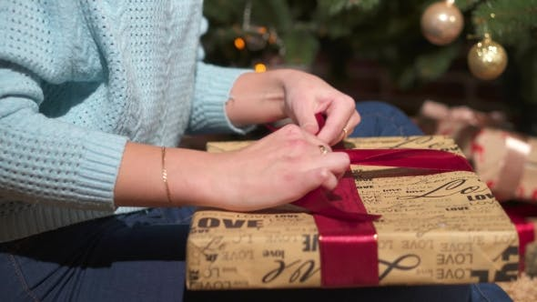 Cover Image for Young Woman Wraping Gifts for Xmas