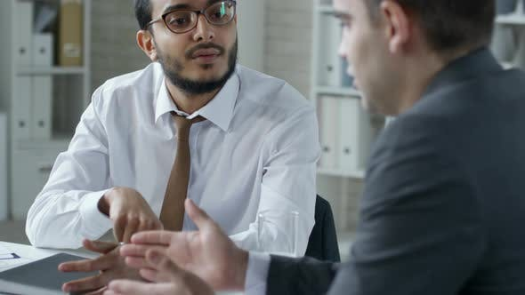 Thumbnail for Middle Eastern Entrepreneur Speaking with Business Partner in Office