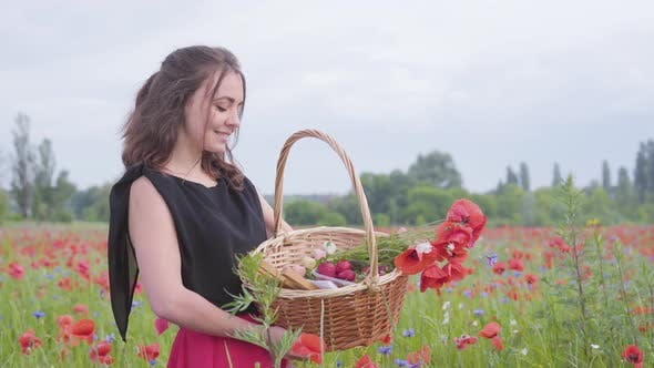 Thumbnail for Portrait of Pretty Young Girl Standing in Poppy Field Holding Wicker Basket with Paint, Strawberry