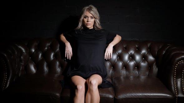 Thumbnail for Beautiful Pregnant Woman in Black Dress Sitting