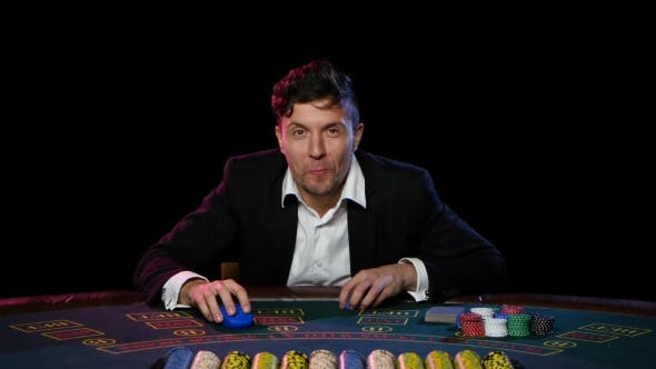 Thumbnail for Man in a Casino Play in Online Poker and Lose.