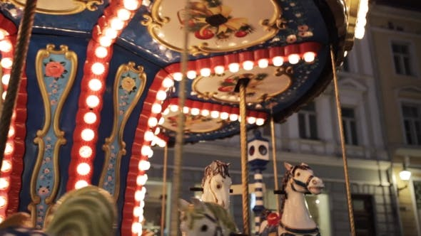 Thumbnail for Illuminated Carousel in Old City at Night