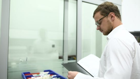 Thumbnail for Scientist Holding Documents