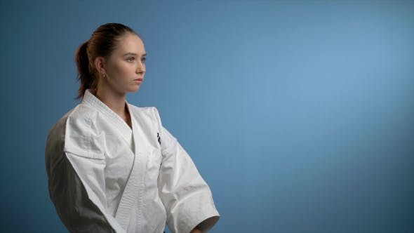 Thumbnail for Young Woman Making Karate Punches Isolated on Blue