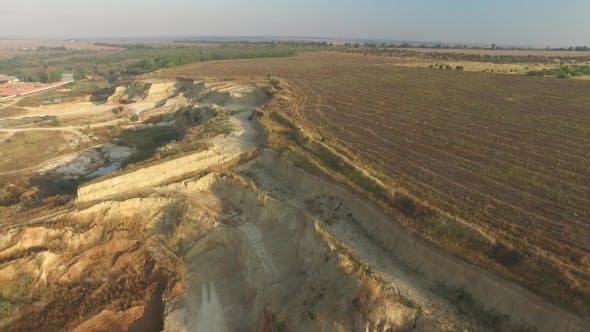Sandy Quarry Near the Arable Land Outside the City