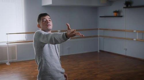 Handsome Male Dancer in Grey Pullover