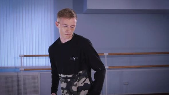 Cover Image for Young Hip-hop Dancer in Black Trousers and Pullover Performing Urbanstyle and Streetdance in the