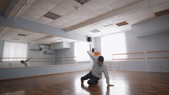 Thumbnail for Hall for Rehearsals. The Dancer in Convenient Clothes Rehearses. He Works the Basic Movements in