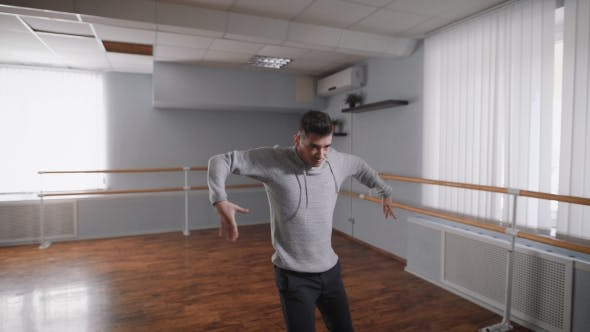 Thumbnail for The Dance Teacher in the Hall for Rehearsals. He Does the Slow and Smooth Movements, Thus Working