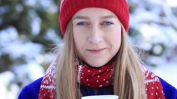 Thumbnail for Young Woman Enjoying Scent of Coffee in Wintertime