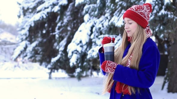 Thumbnail for Lovely Woman in Winter Clothes Enjoying Hot Drink