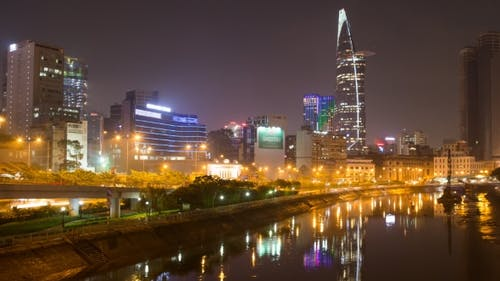 Cityscape of Ho Chi Minh at Night with Bright Illumination of Modern Architecture, Viewed Over