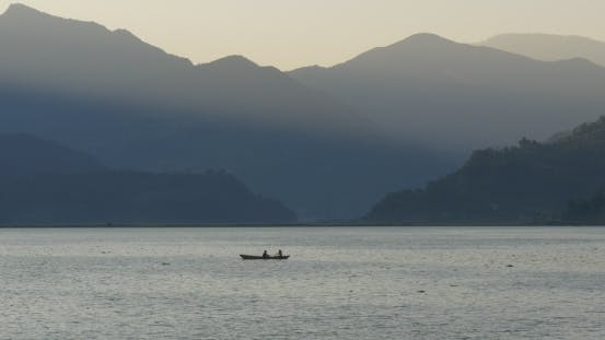 Thumbnail for Tourists Row in a Boat in a Mountain Lake